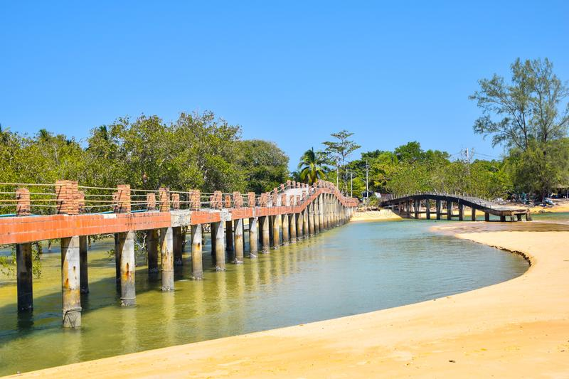 The old bridge on the beach in the afternoon. At Koh Payam, Ranong, Thailand royalty free stock photos