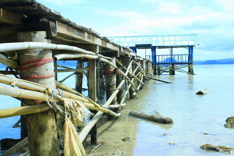 Old bridge on the beach royalty free stock image