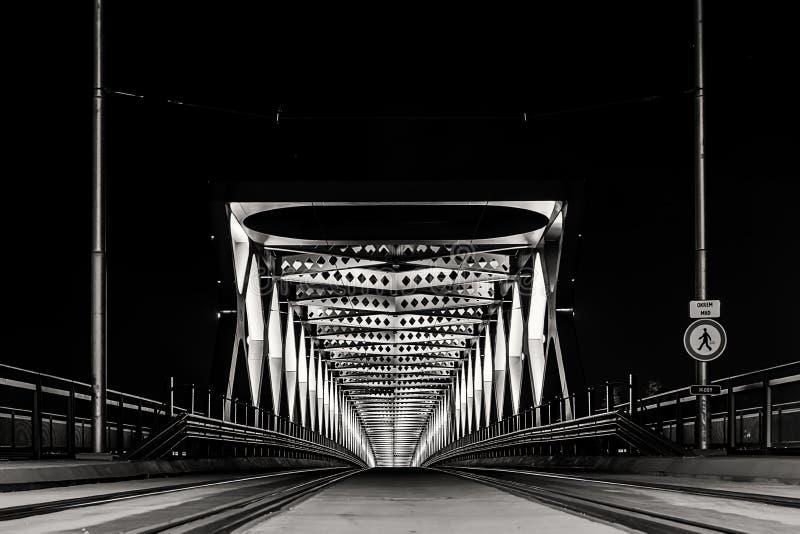 The old bridge in Bratislava is lit at night royalty free stock photo