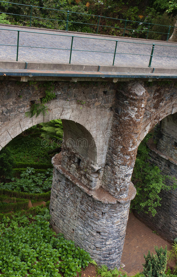 The old bridge with cobblestone road. in Funchal. Arch support of the ancient bridge, Madeira stock photo