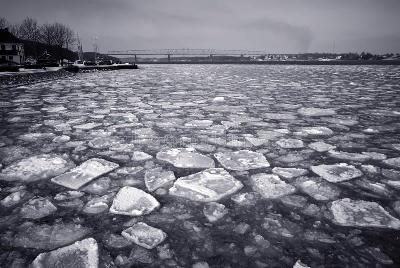 Old bridge and cracked ice stock photography
