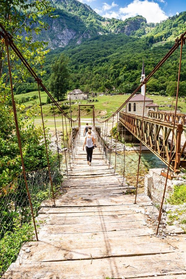Old bridge in Dragobi over river Lumi i Valbones National Park Valbona in Albania, Europe stock images
