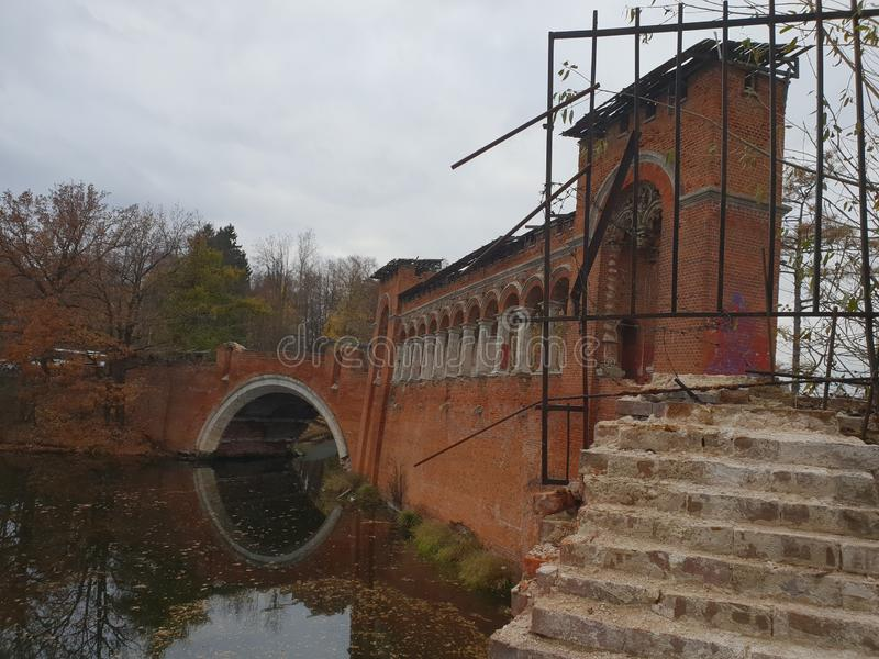 Old bridge on the lake. Sight, architecture royalty free stock images
