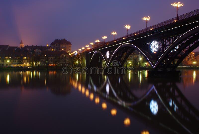 Old Bridge in Maribor. Old Bridge across Drava River in Maribor in Slovenia during Christmas Holidays royalty free stock image