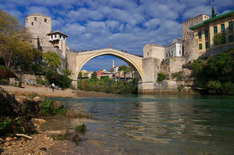 Old bridge in Mostar, Bosnia and Herzegovina, over Neretva river. The bridge was designed by Mimar Hayruddin, a student and apprentice of the Ottoman architect stock photography