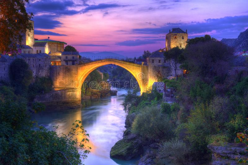 Old bridge in Mostar, Bosnia and Herzegovina, over Neretva river. The bridge was designed by Mimar Hayruddin, a student and apprentice of the Ottoman architect stock photo
