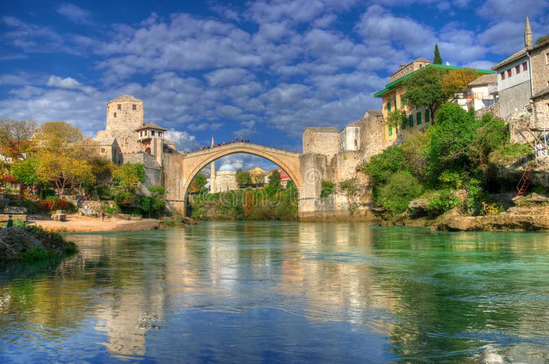 Old bridge in Mostar, Bosnia and Herzegovina, over Neretva river. The bridge was designed by Mimar Hayruddin, a student and apprentice of the Ottoman architect royalty free stock photography