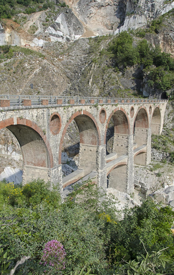 Old bridge of quarry marble in Italy stock photos