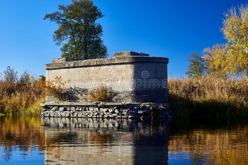 Old bridge support in a river royalty free stock image