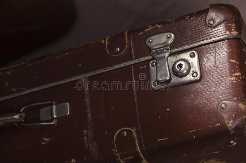 Old briefcase. Closeup of old fashioned aged brown leather brief case standing indoor in studio, horizontal picture stock photo