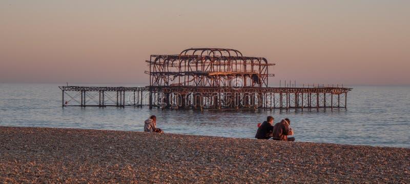 Old Brighton Pier in the sunset - BRIGHTON, UNITED KINGDOM - FEBRUARY 27, 2019 stock image
