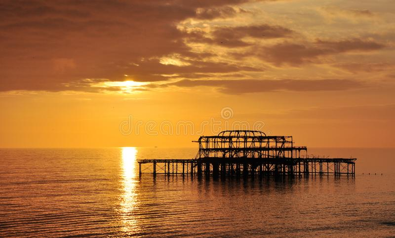 Old Brighton west pier, UK. The view of old Brighton west pier at sunset, Brighton, UK stock image