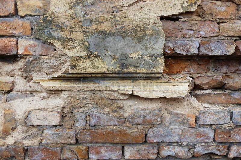 Old brittle stone wall. On an old house royalty free stock photography