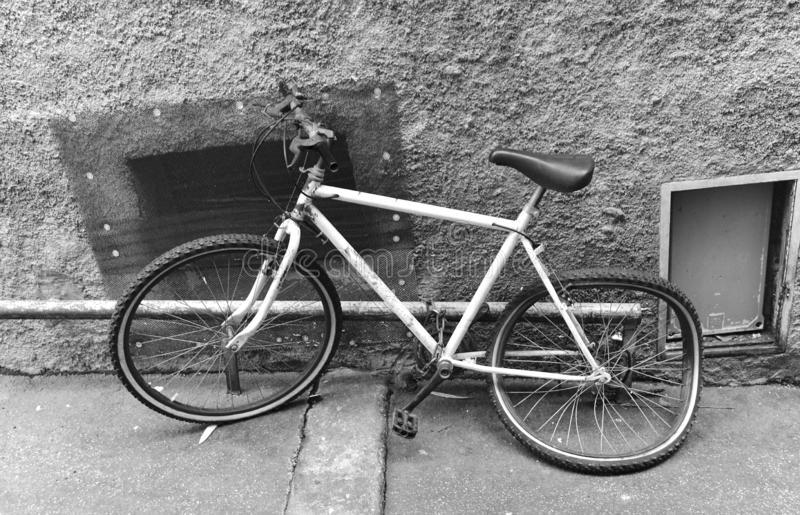 Old broken bike at the wall royalty free stock images