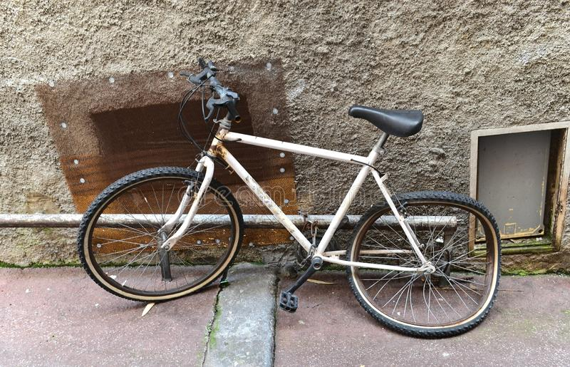 Old broken bike at the wall stock image
