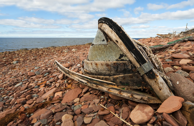 The old, broken boat. On seacoast royalty free stock images