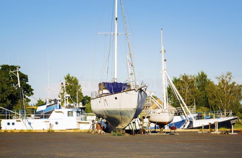 Old and broken boat in repair royalty free stock image