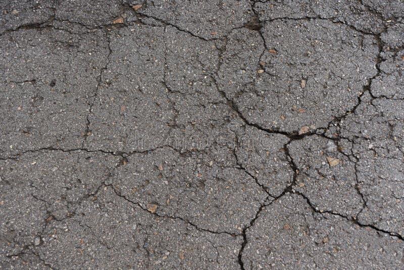 Old broken cracked asphalt texture background stock photography