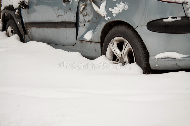 An old broken-down car in the snow stock photo