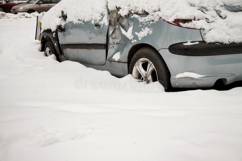 Old broken-down car in the snow royalty free stock photo