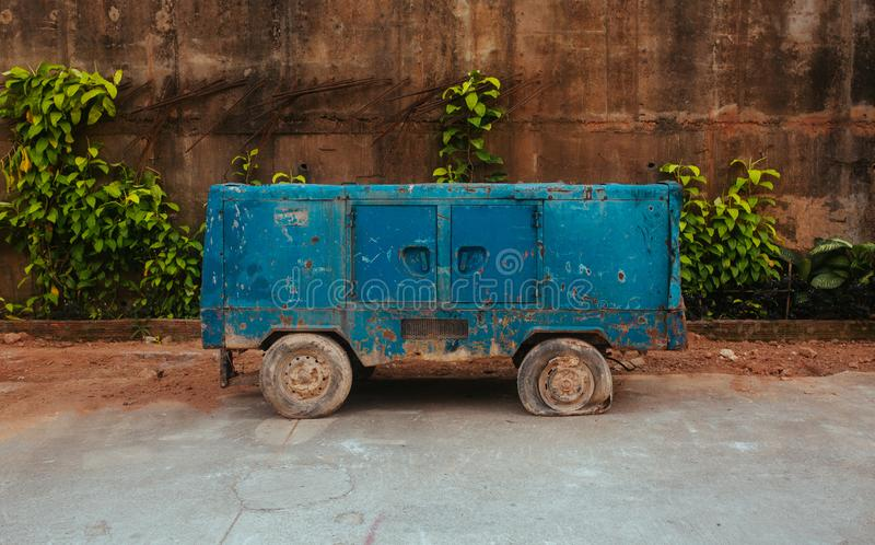 Old Electric Transformer on wheels in Asia. Old Broken Electric Transformer on wheels in Thailand stock image