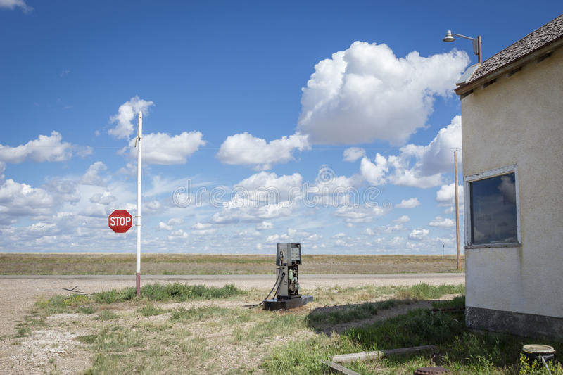 Old broken gas pump sitting on the corner of the road. royalty free stock photography