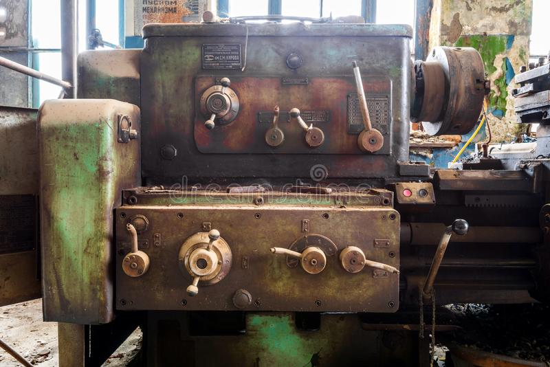 Old broken lathe. Broken lathe on abandoned factory stock images
