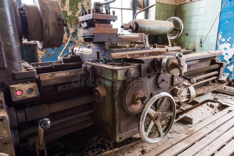 Old broken lathe. Broken lathe on abandoned factory stock photography