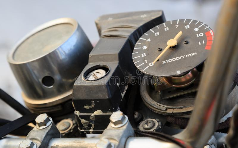 Old broken motorbike speed meter closeup detail view royalty free stock photos