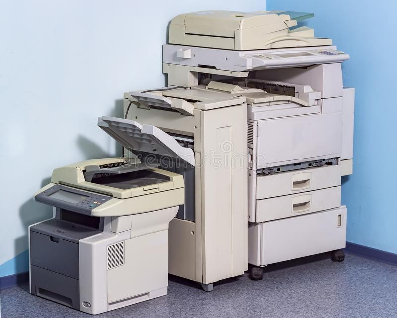 Old broken office equipment stands on the floor in the corner. Business, computer, retro, technology, paper, salvage, ancient, auction, close, collector, color royalty free stock photo