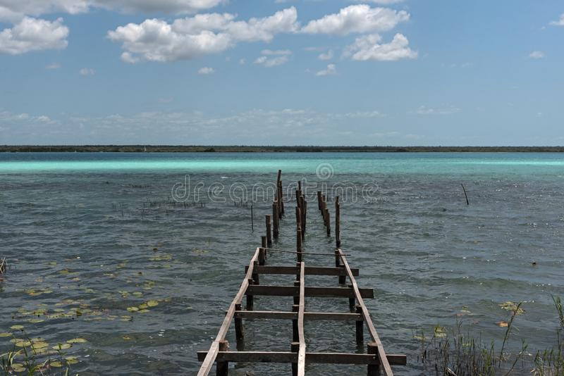 Old broken pier at the lagoon of Bacalar, Quintana Roo, Mexico stock image