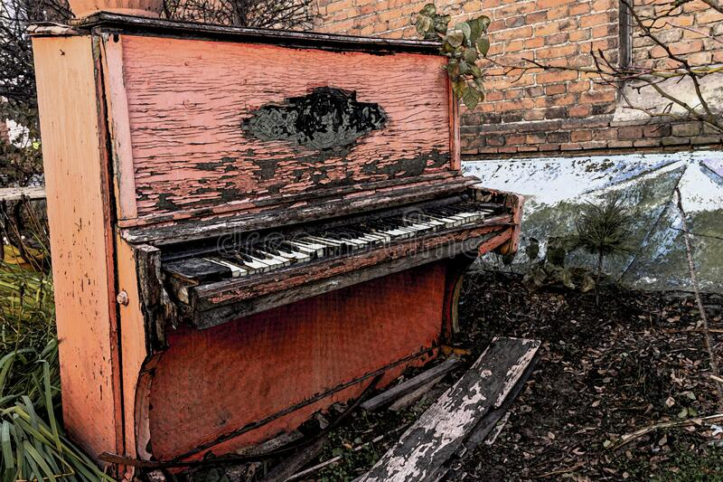 An Old Broken Piano Thrown Into The Street With Peeling ...