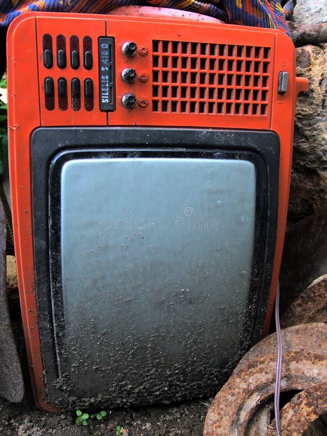 Old broken red TV stock photos