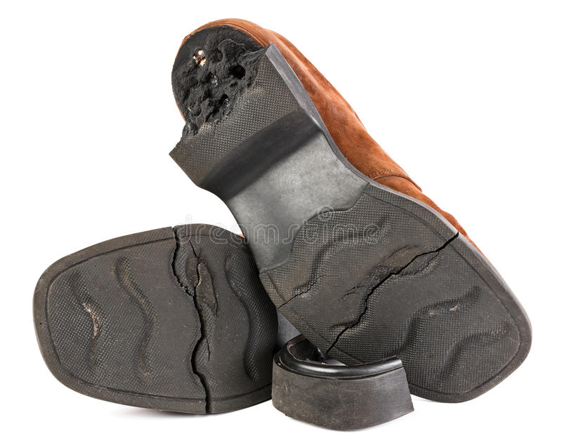 Old broken shoes with cracked sole stock photography