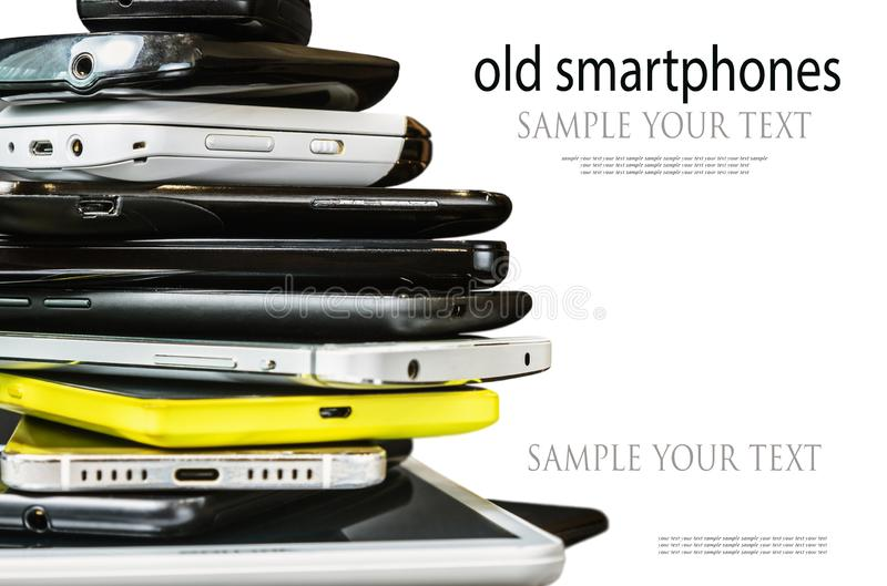 Old and broken smartphones and mobile phones stock photos