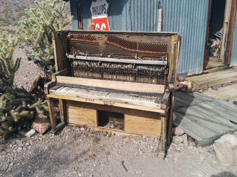 Old, broken Straube piano in front of desert shack stock photos