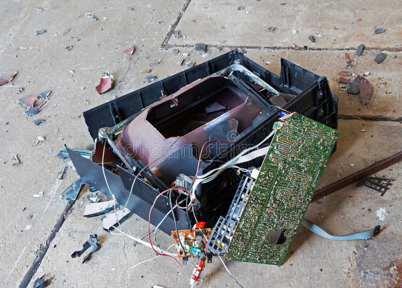 Old broken television on concrete floor stock image