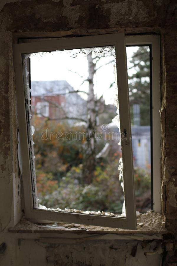 Old broken window with a view to the outside royalty free stock photography