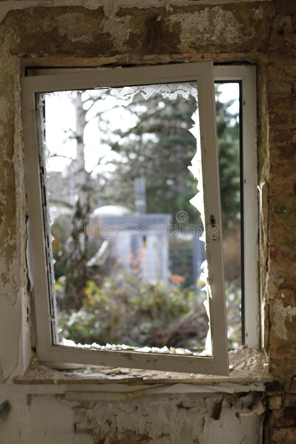 Old broken window with a view to the outside royalty free stock image