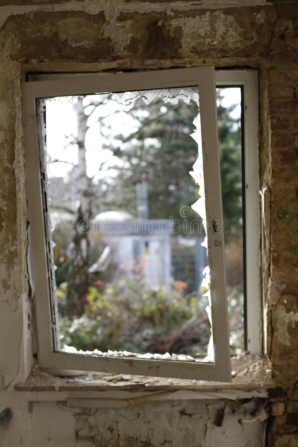 Old broken window with a view to the outside stock photos