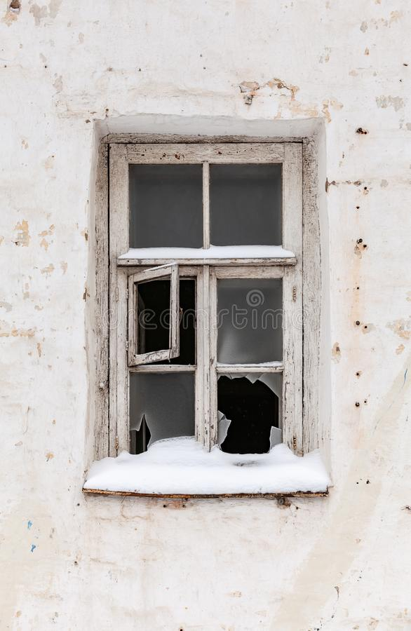 Old broken window in white wall royalty free stock photography