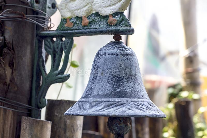 Old bronze bells were hung at wooden stakes. royalty free stock image