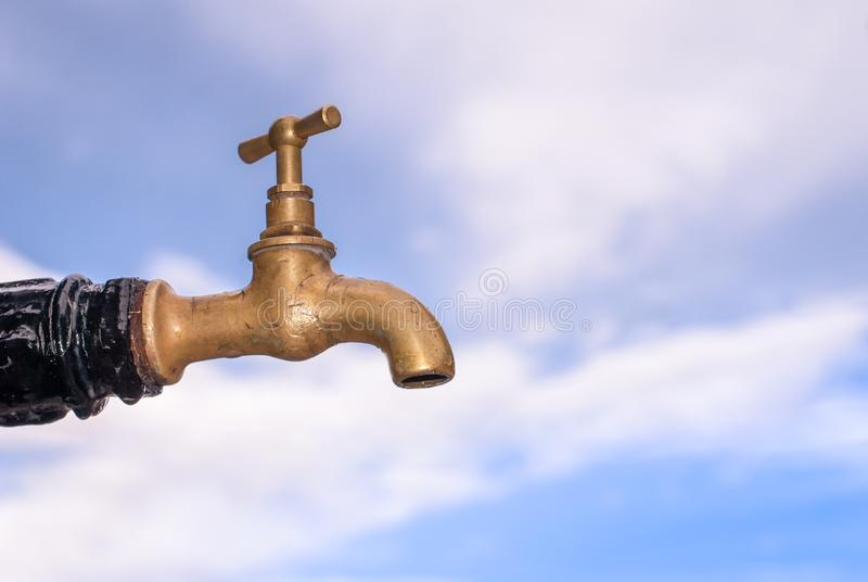 Old bronze faucet closed with scratches stock photo