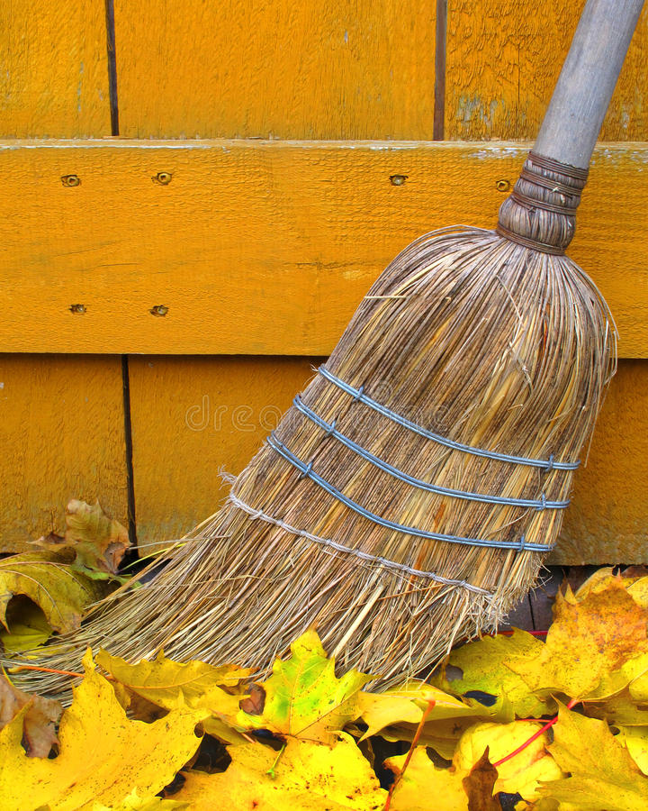 Old Broom And Autumn Leaves Stock Image