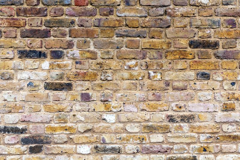 Old brown, aged, crumbling, brown brick wall. royalty free stock photography