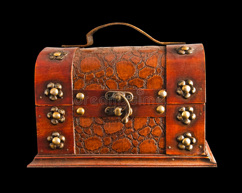 Old brown chest isolated. On a black background stock images