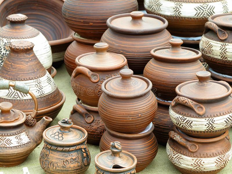 Old brown clay ceramic pottery retro handmade vases stock images