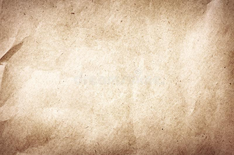 Old brown crumpled and recycled vintage paper texture or background stock photo