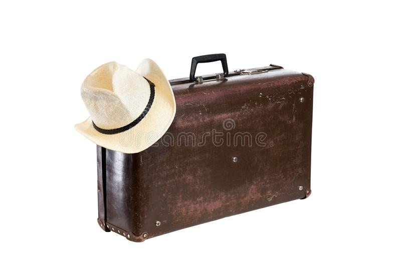 Old brown fiber suitcase with hat isolated on white background stock image