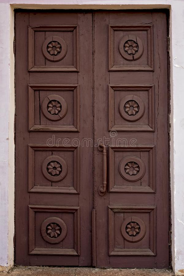 Old brown house door. Wooden vintage building gate weathered. Closed doorway. royalty free stock photos